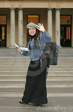 University - Student waving to fellow students