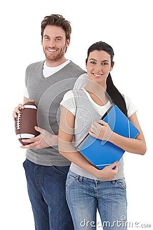 University students holding folders and football Stock Photo