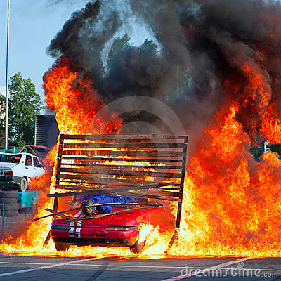Unknown driver and stuntman pass through fire Editorial Stock Image