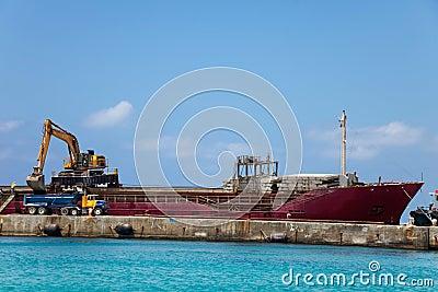Unloading dirt from ship
