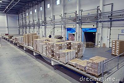 Unloading system, inside warehouse doors loading dock.