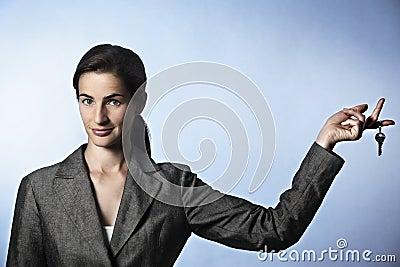 Unlock opportunities: woman holding key between fi