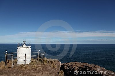 Unmanned Lighthouse high on cliffs