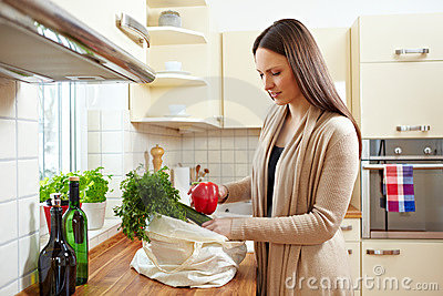 Unpacking groceries in kitchen
