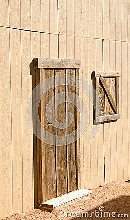Unpainted wooden barn door and window