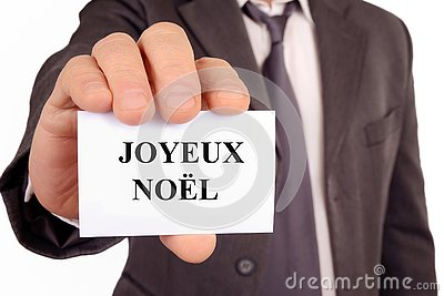 Merry Christmas written in French on a card Stock Photo