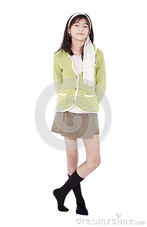 Free Unsmiling Confident Young Girl In Green Sweater Standing, Isolat Stock Image - 29253101