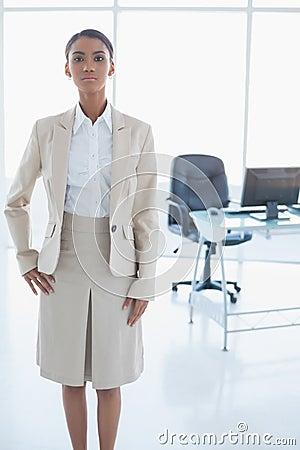 Unsmiling elegant businesswoman posing