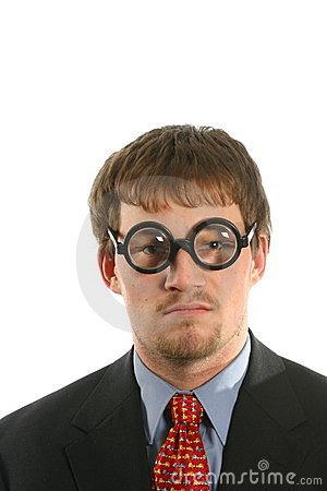 Unusual expression on man with thick glasses in business suit