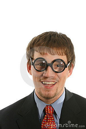 Unusual expression with smile on man with thick glasses in business suit