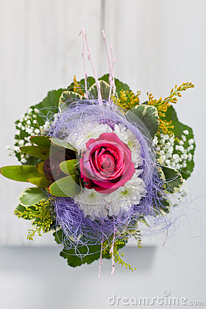 Unusual floral posy incorporating a blue textile