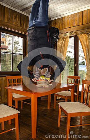 Free Unusual Foreshortening Of A Man Trying To Eat Fruit Upside Down Royalty Free Stock Photo - 114916705