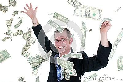 Uomo attraente di affari in soldi di lancio del vestito in aria