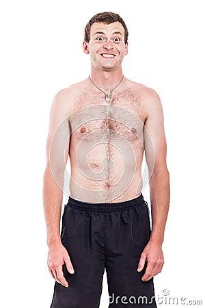 Uomo senza camicia con il sorriso a trentadue denti