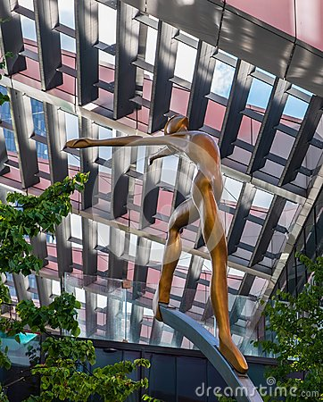 Up There-Sculpture on First Street, Manchester. One of five 2.5m sculptures set on 5m stainless steel columns by Collin Editorial Stock Photo