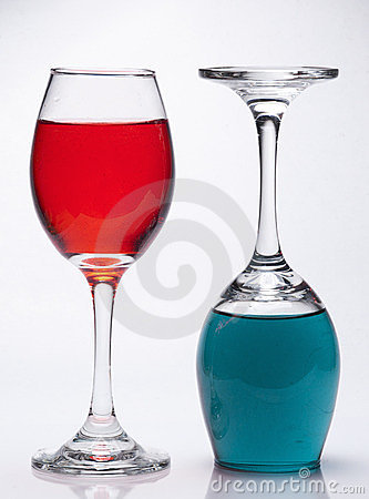 Upright and upside down filled wine glasses
