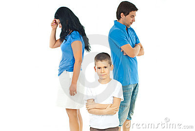 Upset boy between parents problems