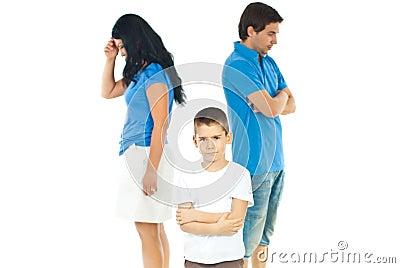 Upset boy between parents problems