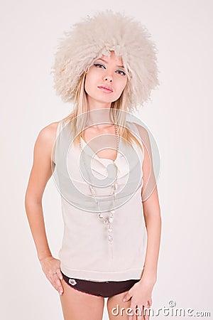 Upset girl in furry hat