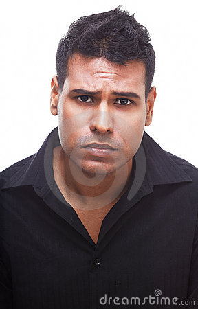 Upset Indian businessman frowning and disappointed