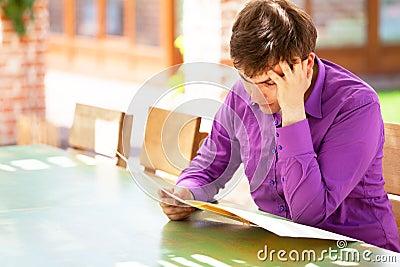 Upset man looking in the menu