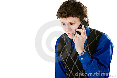 Upset man talking with mobile phone