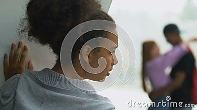 Upset Mixed Race Girl Watching Boyfriend Cheating Outdoor Broken