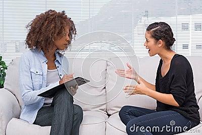 Upset woman speaking to her therapist