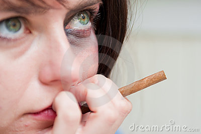 Upset young woman with a bruised eye