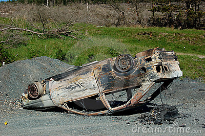 Upside down burnt-out car
