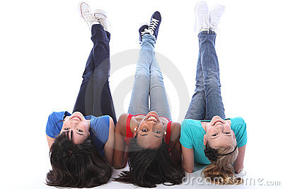 Upside down fun for three student girl friends