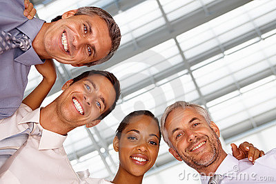 Upward view of business team smiling together