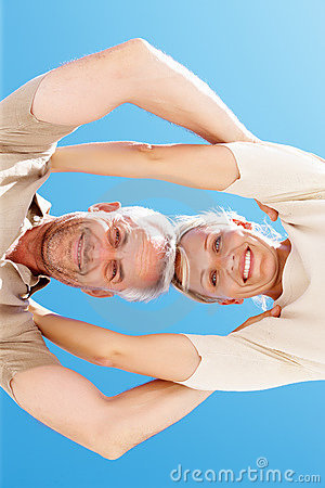 Upward view of a senior couple with heads together