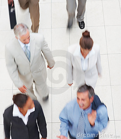 Upward view of a team of business people, walking