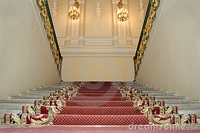 Upwards on a red carpet.