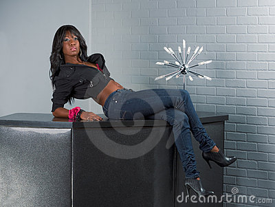 Urban African American woman lying on table