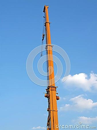 Urban auto yellow crane, blue sky, clouds
