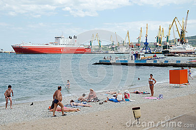 Urban beach in Feodosia background Seaport Editorial Photography