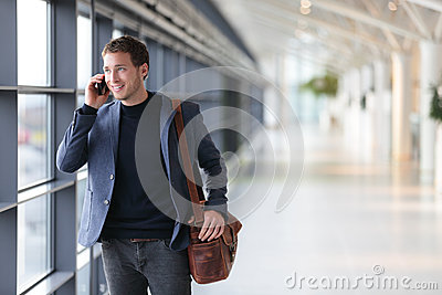 Urban business man talking on smart phone