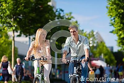 Urban couple riding  bike in free time