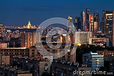 Urban panorama in blue summer night