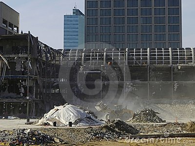 Urban renewal: excavator and dusty demolition