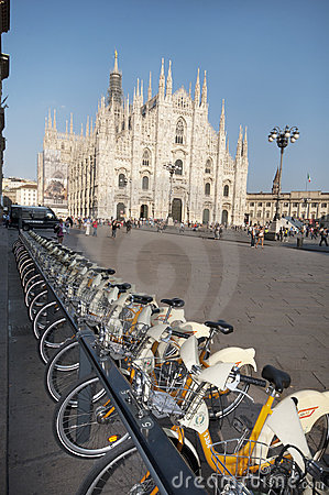 Urban scene of Milan and bikes for urban transport Editorial Image