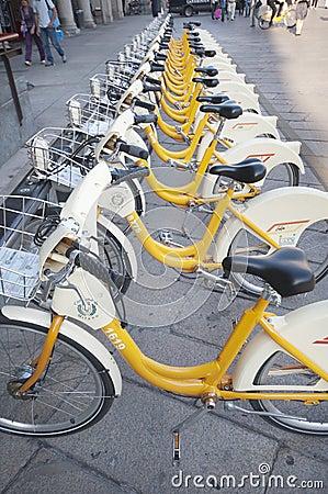 Urban scene of Milan and bikes for urban transport Editorial Stock Image