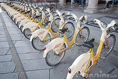 Urban scene of Milan and bikes for urban transport Editorial Stock Photo