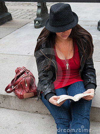 Urban Woman Reading in City
