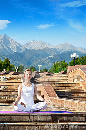 Urban Yoga meditation in ardha padmasana