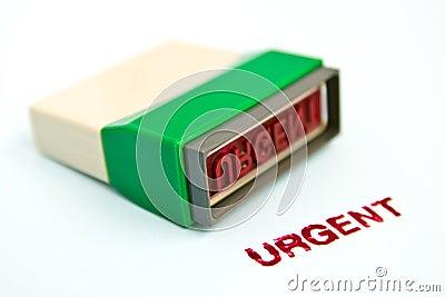 Urgent letter on green rubber stamp