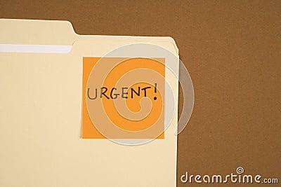 Urgent sticky note.