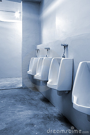 Urinals in bathroom at office